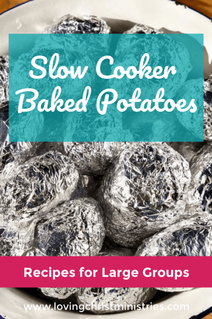image of foil wrapped potatoes in a slow cooker with title text overlay - Slow Cooker Baked Potatoes | Perfect for Large Groups
