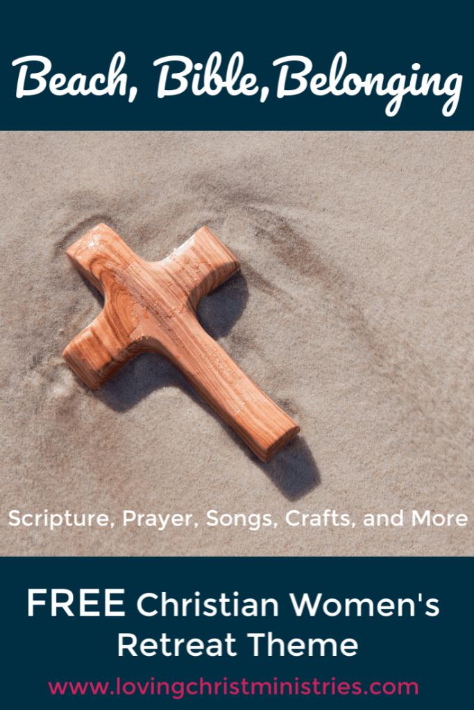 Wooden cross laying on sandy beach with title text overlay - Beach, Bible, Belonging Women's Retreat Theme.