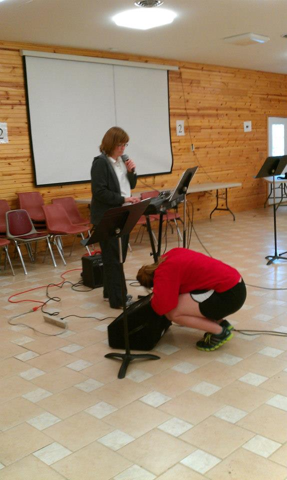 image of Angie setting up music for Loving Christ Ministries