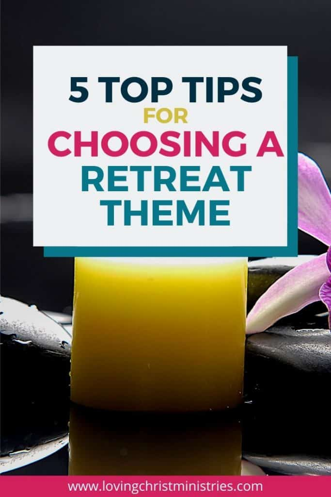 image of lighted yellow candle and purple flower with title text overlay - Top Tips to Choose a Theme for Women's Retreats