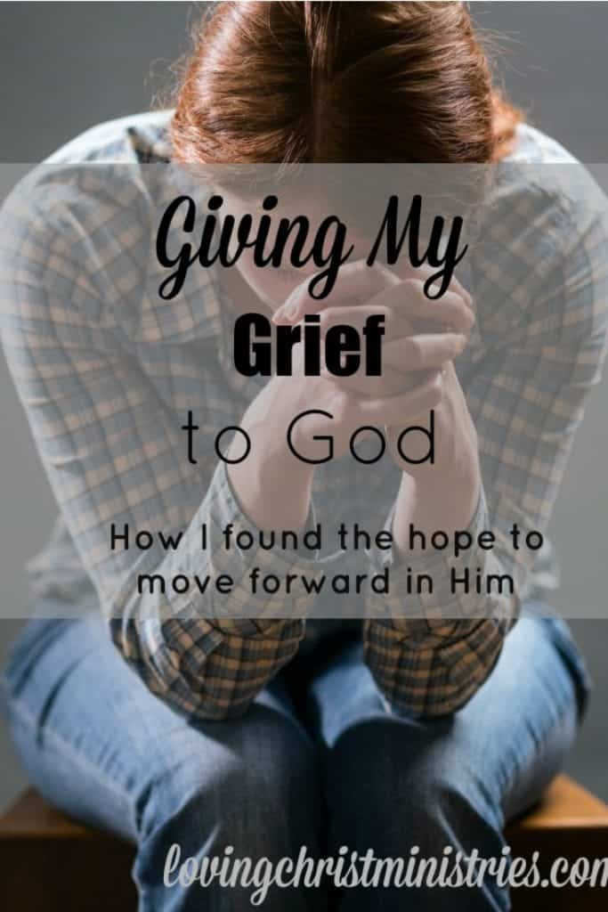 image of woman with head in hands and title text overlay - Giving My Grief to God