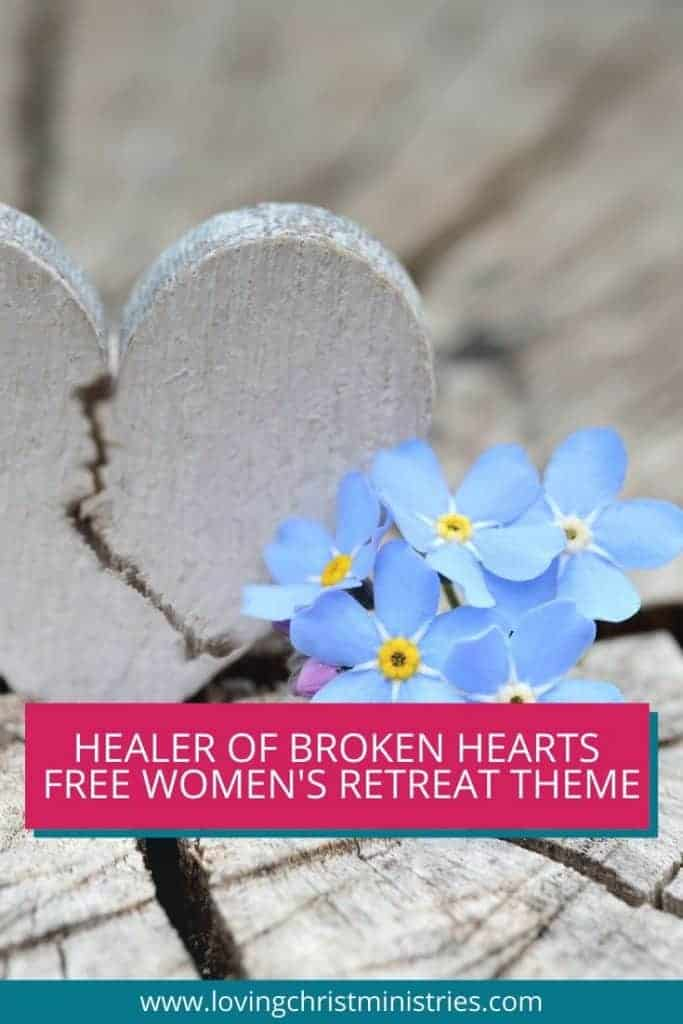 image of wooden broken heart and blue forget me not flowers with title text overlay - Free Healer of Broken Hearts Christian Women's Retreat Theme