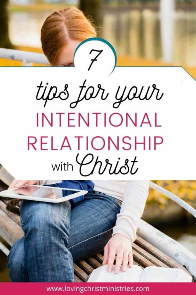 image of red haired woman sitting on bench reading Bible with title text overlay - 7 Tips for Your Intentional Relationship with Christ -Loving Christ Ministries