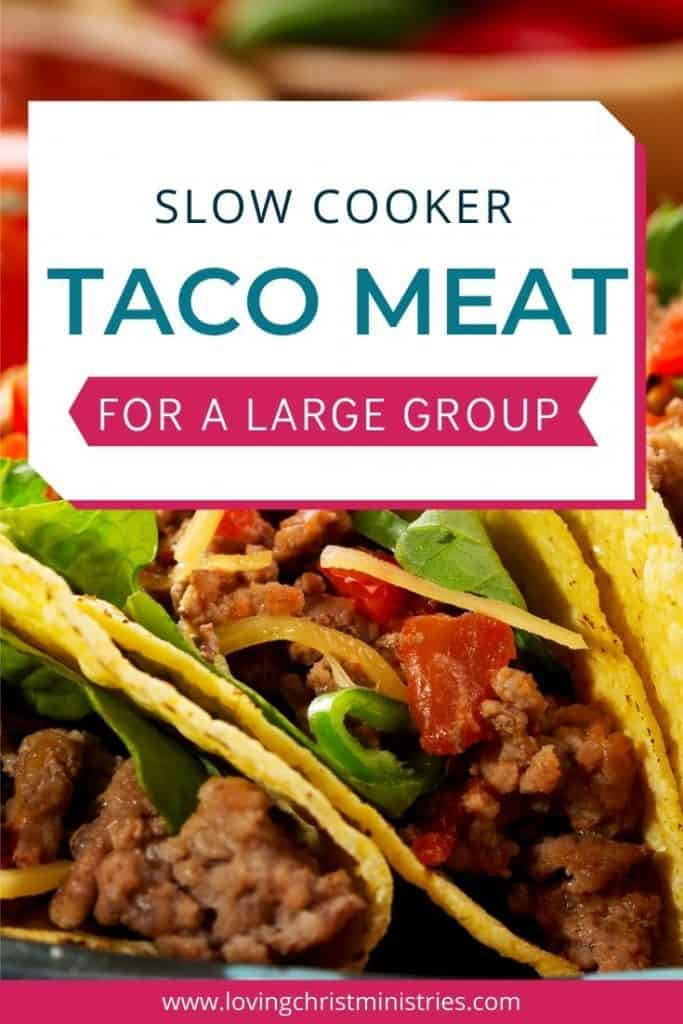 image of beef tacos with title text overlay - Slow Cooker Taco Meat Recipe for Large Groups